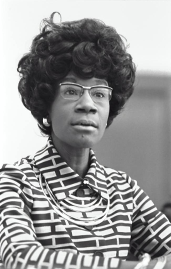 Image of a lady with glasses and pattern shirt